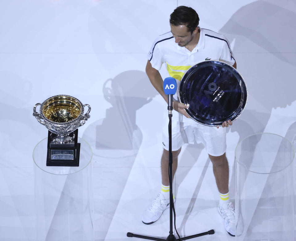Russia's Daniil Medvedev holds his runners' up trophy after losing to Serbia's Novak Djokovic in the men's singles final at the Australian Open tennis championship in Melbourne, Australia, Sunday, Feb. 21, 2021. (AP Photo/Hamish Blair)