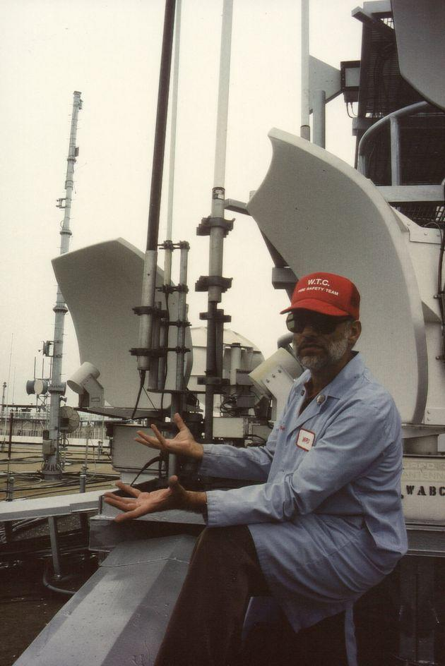 Steven Jacobson perched on the roof of One World Trade Center, pointing out the repeater transmitters, circa 1981. (Photo: Photo Courtesy of Miriam Jacobson)