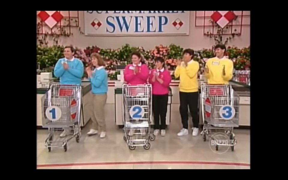"""<p>In the 90s version of the show, each team was given a designated sweatshirt, which the contestants had to wear. The contestants <a href=""""https://www.youtube.com/watch?v=DLeVYtsQyhE&feature=youtu.be"""" rel=""""nofollow noopener"""" target=""""_blank"""" data-ylk=""""slk:changed into their team's sweatshirt"""" class=""""link rapid-noclick-resp"""">changed into their team's sweatshirt</a> for the final two segments of the show–the Big Sweep and the Bonus Sweep.</p>"""