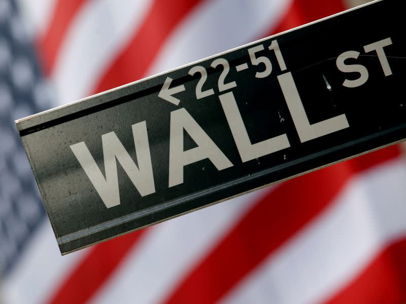 FILE PHOTO: A street sign is seen in front of the New York Stock Exchange on Wall Street in New York