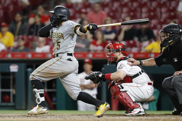 Pittsburgh Pirates' Josh Harrison follows through on a triple that drove in the go-ahead run off Cincinnati Reds relief pitcher Dylan Floro during the 12th inning of a baseball game Wednesday, May 23, 2018, in Cincinnati. The Pirates won 5-4. (AP Photo/John Minchillo)