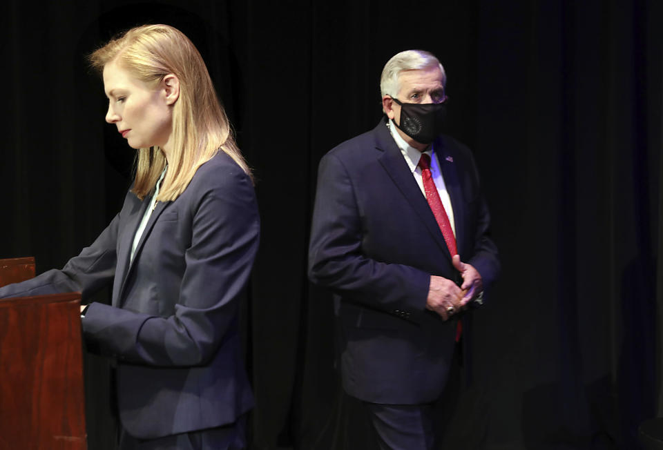 FILE - In this Oct. 9, 2020, file photo, Missouri gubernatorial candidates, Gov. Mike Parson, and State Auditor Nicole Galloway are seen onstage before the Missouri gubernatorial debate at the Missouri Theatre in Columbia, Missouri. They are opposing each other in the Nov. 3, 2020, general election. (Robert Cohen/St. Louis Post-Dispatch via AP, Pool, File)