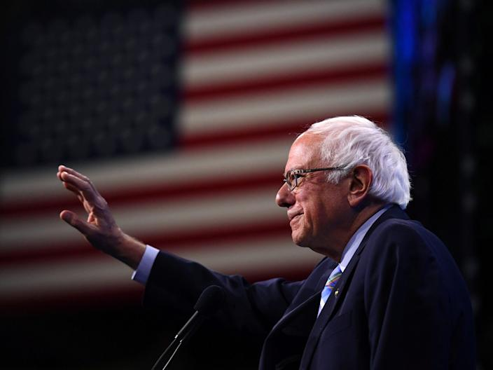 FILE PHOTO: Democratic 2020 U.S. presidential candidate and U.S. Senator Bernie Sanders (D-VT) takes the stage at the New Hampshire Democratic Party state convention in Manchester, New Hampshire, U.S. September 7, 2019. REUTERS/Gretchen Ertl/File Photo