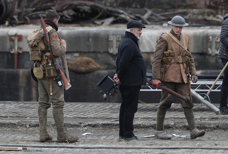 Director Sam Mendes and Actor George Mackay(r) on set of Sam Mendes new film 1917 during filming at Govan Docks in Glasgow.PRESS ASSOCIATION Photo. Picture date:Tuesday June 12, 2019. Photo credit should read: Andrew Milligan/PA Wire (Photo by Andrew Milligan/PA Images via Getty Images)