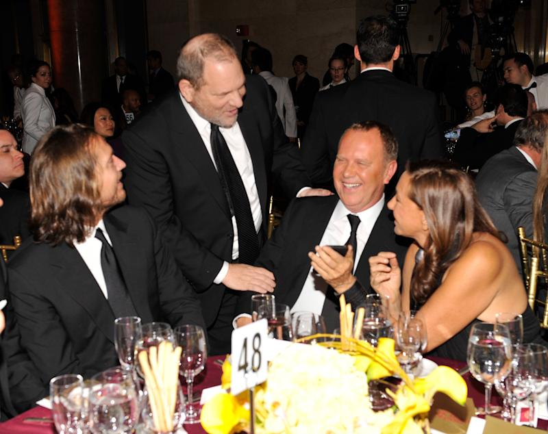 Harvey Weinstein, Michael Kors and Donna Karan at the amfAR gala in 2011.