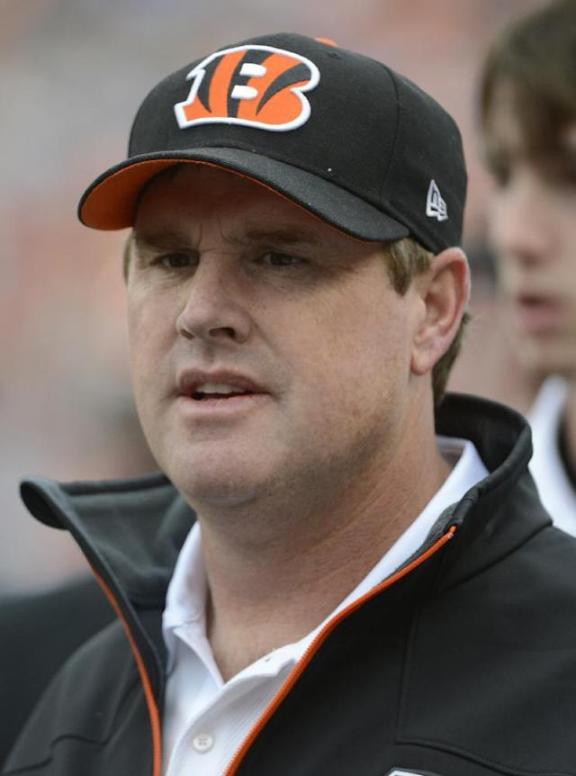 FILE - In this Nov. 11, 2012, file photo, Cincinnati Bengals offensive coordinator Jay Gruden stands on the sidelines during an NFL football game against the New York Giants, in Cincinnati. Jay Gruden has agreed to become the head coach of the Washington Redskins. The Redskins confirmed Thursday, Jan. 9, 2014, that Gruden has accepted the job and will be introduced at an afternoon news conference. (AP Photo/Michael Keating, File)