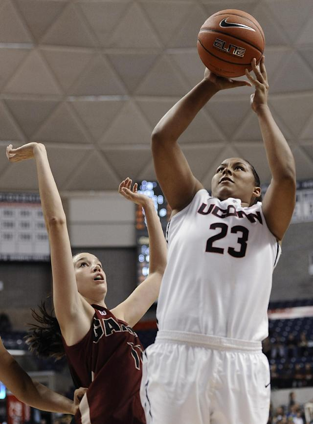 Connecticut's Kaleena Mosqueda-Lewis, right, shoots over Gannon's Jen Papich, during the second half of an NCAA college exhibition basketball game, Friday, Nov. 1, 2013, in Storrs, Conn. Connecticut won 101-35. (AP Photo/Jessica Hill)