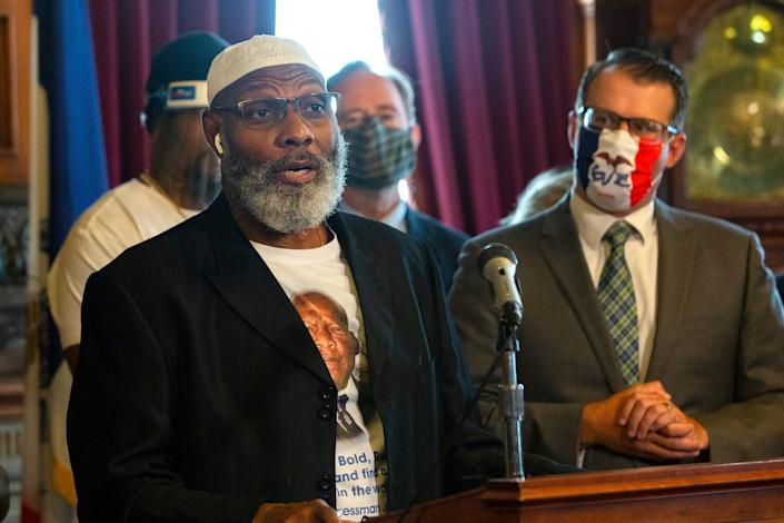 State Rep. Ako Abdul-Samad speaks following Gov. Kim Reynolds' signing of Executive Order 7, which restores the right to vote for Iowans who have completed felony sentences. Iowa had been the last state to permanently prohibit convicted felons from voting.