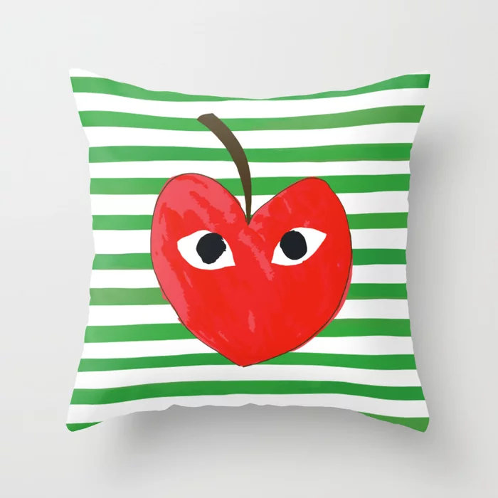 """Why let t-shirts and sneakers have all the trendy label-repping fun?<br><br><strong>katemargoli</strong> Pomme des Garçons Throw Pillow, $, available at <a href=""""https://go.skimresources.com/?id=30283X879131&url=https%3A%2F%2Fsociety6.com%2Fproduct%2Fpomme-des-garcons_pillow"""" rel=""""nofollow noopener"""" target=""""_blank"""" data-ylk=""""slk:Society6"""" class=""""link rapid-noclick-resp"""">Society6</a>"""