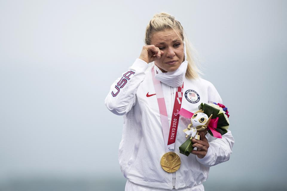 Gold medallist Oksana Masters of the US reacts on the podium after competing in the women's cycling road individual H4-5 time trial during the Tokyo 2020 Paralympic Games at the Fuji International Speedway in Oyama on August 31, 2021. (Photo by CHARLY TRIBALLEAU / AFP) / The erroneous mention[s] appearing in the metadata of this photo by CHARLY TRIBALLEAU has been modified in AFP systems in the following manner: [August 31] instead of [August 30]. Please immediately remove the erroneous mention[s] from all your online services and delete it (them) from your servers. If you have been authorized by AFP to distribute it (them) to third parties, please ensure that the same actions are carried out by them. Failure to promptly comply with these instructions will entail liability on your part for any continued or post notification usage. Therefore we thank you very much for all your attention and prompt action. We are sorry for the inconvenience this notification may cause and remain at your disposal for any further information you may require. (Photo by CHARLY TRIBALLEAU/AFP via Getty Images)