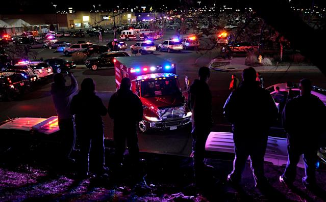 <p>People watch an ambulance leave at the scene of a shooting at a Walmart in Thornton, Colo., Nov. 1, 2017. (Photo: Rick Wilking/Reuters) </p>
