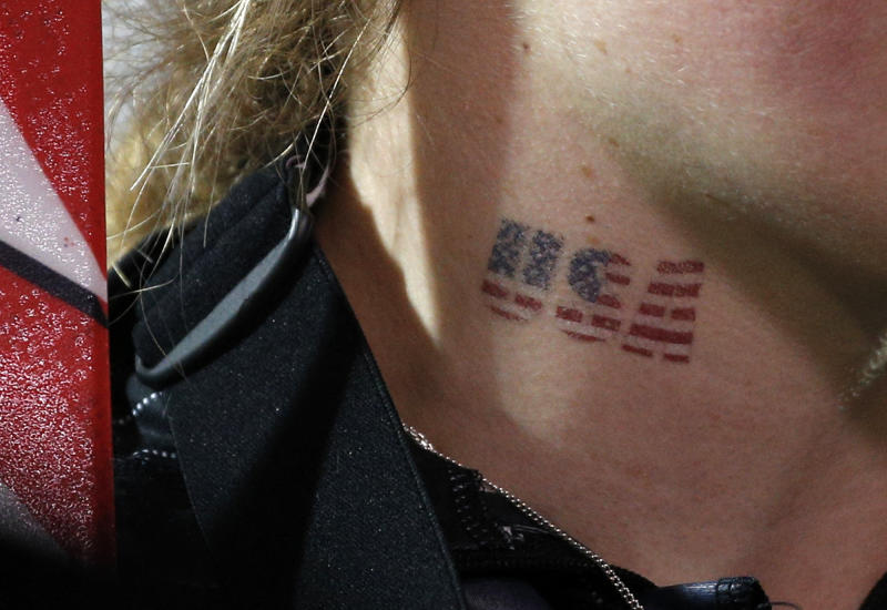 United States' Mikaela Shiffrin wears a temporary tattoo as she celebrates her gold medial win in the women's slalom at the Sochi 2014 Winter Olympics, Friday, Feb. 21, 2014, in Krasnaya Polyana, Russia. (AP Photo/Christophe Ena)