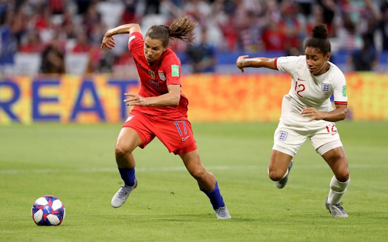 Tobin Heath of the USA runs with the ball under pressure from Demi Stokes of England during the 2019 FIFA Women's World Cup France Semi Final - Robert Cianflone/Getty Images