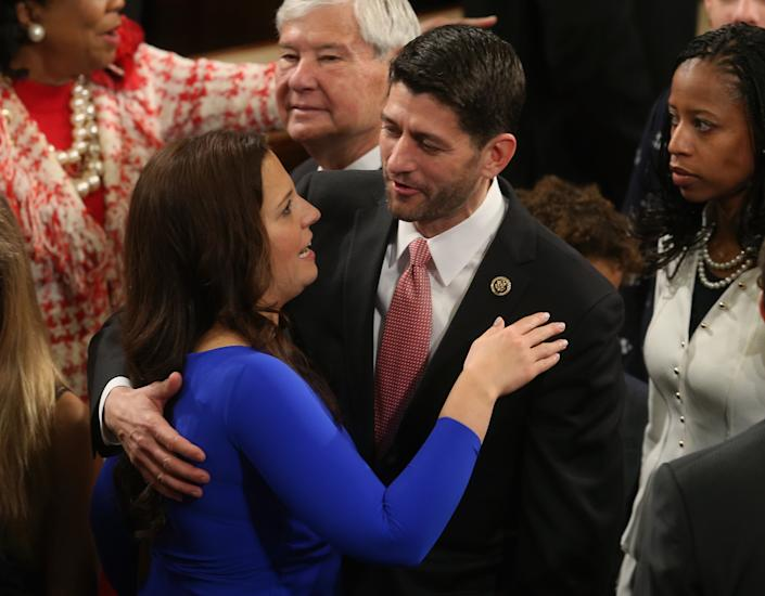 U.S. Rep. Elise Stefanik (R-NY)(L) gets a hug from U.S. Rep. Paul Ryan (R-WI) before the start of the first session of the 114th Congress in the House Chambers January 6, 2015 in Washington, DC. (Mark Wilson/Getty Images)