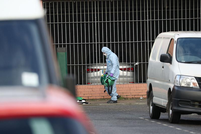 A forensics officer moves medical bags at the scene in Seven Kings, Ilford, east London, where three people died after being stabbed on Sunday (Picture: PA)