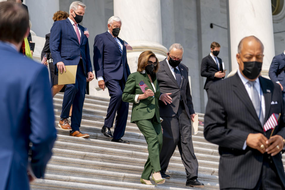 From left, House Minority Leader Kevin McCarthy of Calif., House Majority Leader Steny Hoyer of Md., House Speaker Nancy Pelosi of Calif., and Senate Majority Leader Chuck Schumer of N.Y., and other Members of Congress arrive for a Congressional Remembrance Ceremony marking the 20th anniversary of the Sept. 11, 2001, terrorist attacks, on Capitol Hill in Washington, Monday, Sept. 13, 2021. (AP Photo/Andrew Harnik)
