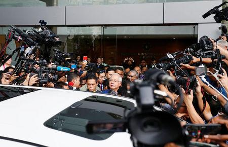 Malaysia's former prime minister Najib Razak (C) speaks to journalists as he leaves after giving a statement to the Malaysian Anti-Corruption Commission (MACC) in Putrajaya, Malaysia May 22, 2018. REUTERS/Lai Seng Sin