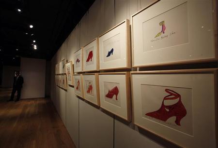 Illustrations of shoes by U.S. artist Andy Warhol are displayed at Sotheby's Hong Kong Gallery September 11, 2013.