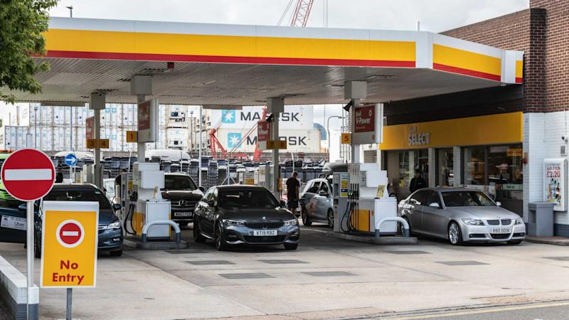 Drivers filling up at Shell petrol station in Portsmouth UK