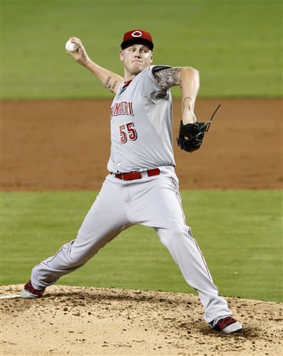Cincinnati Reds' Mat Latos pitches against the Miami Marlins in the second inning of a baseball game in Miami, Sunday, Sept. 16, 2012. (AP Photo/Alan Diaz)