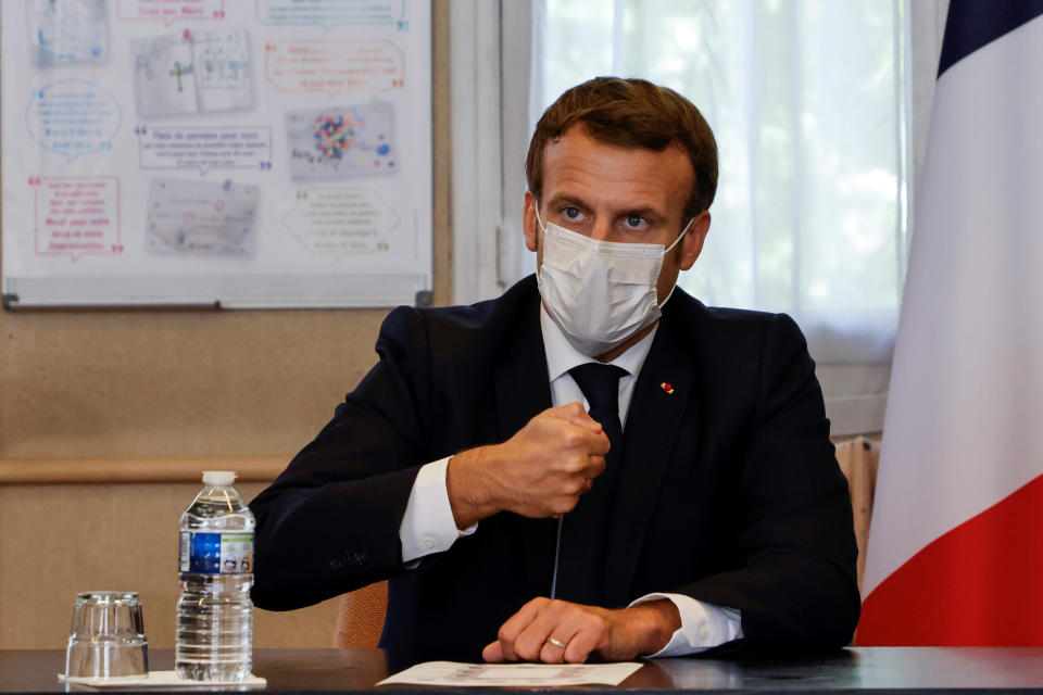 "French President Emmanuel Macron chairs a meeting with the medical staff of the Rene Dubos hospital center, in Pontoise, outside Paris, Friday Oct. 23, 2020. French Prime Minister Jean Castex said Thursday a vast extension of the nightly curfew that is intended to curb the spiraling spread of the coronavirus, saying ""the second wave is here."" The curfew imposed in eight regions of France last week, including Paris and its suburbs, is being extended to 38 more regions and Polynesia, (Photo by Ludovic Marin, Pool via AP)"
