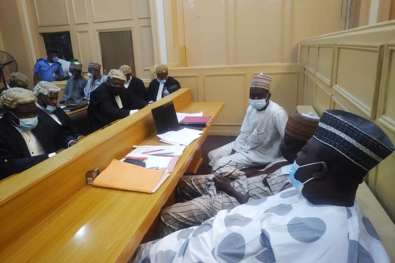 General view of a cross session of court workers facing lawyers during a hearing of a blasphemy case in Kano