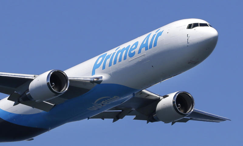 "A Boeing 767 with an Amazon.com ""Prime Air"" livery flies over Lake Washington, Friday, Aug. 5, 2016, as part of the Boeing Seafair Air Show. Amazon unveiled its first branded cargo plane Thursday, one of 40 freighters that will make up the company's own air transportation network of 40 Boeing jets leased from Atlas Air and Air Transportation Services Group, which will operate the air cargo network. (AP Photo/Ted S. Warren)"