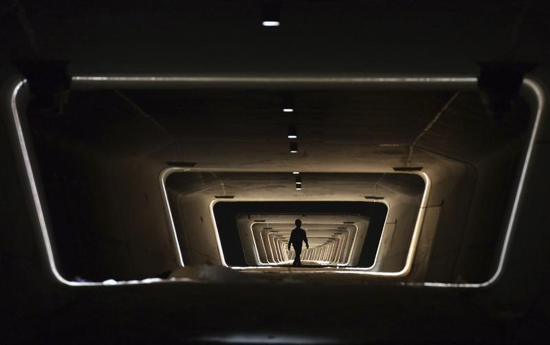 A worker walks in the foundation of a new railway line in Yiwu