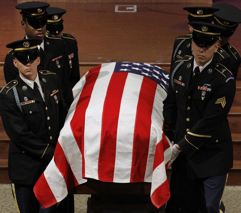 Military honor guard carry the casket of Staff Sgt. Joshua D. Powell during funeral services in Springfield, Ill. Tuesday, Sept. 28, 2010. Twenty-five-year-old Staff Sgt. Joshua D. Powell of Pleasant Plains died in a helicopter crash Sept. 21 during combat operations in Zabul province, Afghanistan. He was assigned to the U.S. Army's 101st Airborne Division at Fort Campbell, Ky. (AP Photo/Seth Perlman)