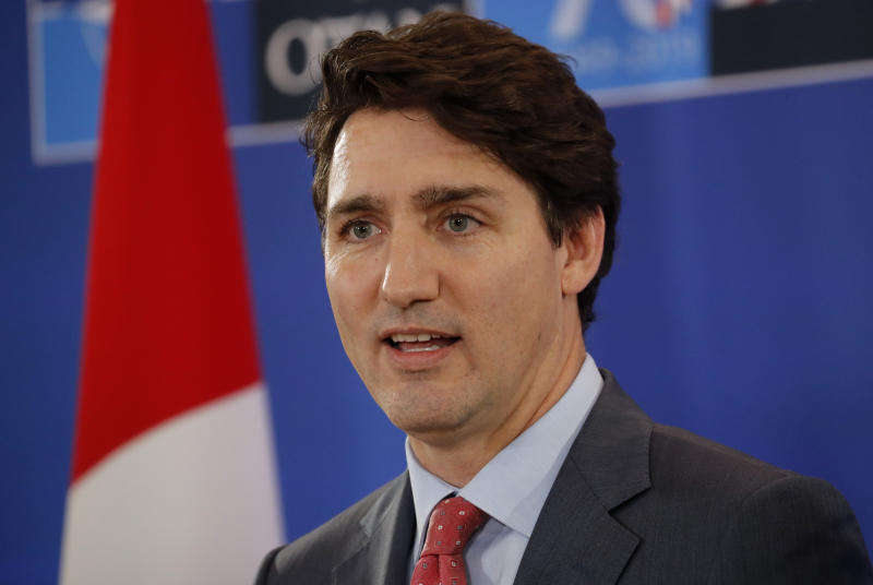 Canadian Prime Minister Justin Trudeau speaks during a media conference at the conclusion of a NATO leaders meeting at The Grove hotel and resort in Watford, Hertfordshire, England, Wednesday, Dec. 4, 2019. NATO leaders papered over their differences Wednesday and vowed to respond as one to an attack on any of the 29 member countries, despite divisions over the priorities of the world's biggest security organization. (AP Photo/Frank Augstein)
