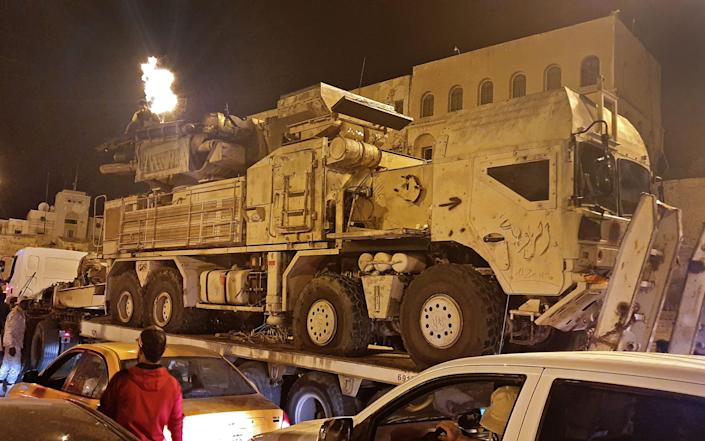 Forces loyal to Libya's UN-recognised Government of National Accord (GNA) parade a Pantsir air defense system truck in the capital Tripoli - MAHMUD TURKIA/AFP