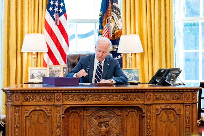 President Joe Biden signs the American Rescue Plan on March 11, 2021, in Washington, D.C.