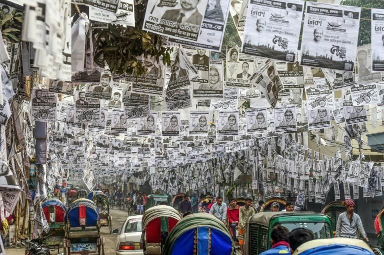 Bangladesh's High Court has ordered a halt to the production, display and disposal of plastic-laminated posters for the mayoral and council elections (AFP Photo/Munir UZ ZAMAN)