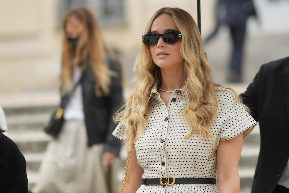 PARIS, FRANCE - JULY 05: Jennifer Lawrence wears sunglasses, a white dress with short sleeves and polka dots, a Dior thin leather belt, outside Dior, during Paris Fashion Week - Haute Couture Fall/Winter 2021/2022, on July 05, 2021 in Paris, France. (Photo by Edward Berthelot/Getty Images)