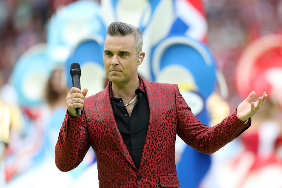 British pop star Robbie Williams flipped the bird on camera during the opening ceremony prior to the 2018 FIFA World Cup Russia Group A match between Russia and Saudi Arabia. (Photo by Catherine Ivill/Getty Images)