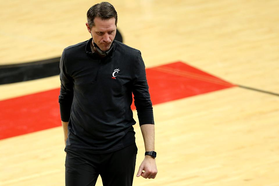 John Brannen walks back to the bench during Cincinnati's game against Memphis on Feb. 28 at Fifth Third Arena in Cincinnati. The Memphis Tigers won, 80-74.