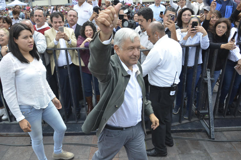 Mexico's President-elect Andres Manuel Lopez Obrador arrives to a rally commemorating the 50th anniversary of a bloody reprisal against students, at the Tlatelolco Plaza in Mexico City, Saturday, Sept. 29, 2018. Lopez Obrador vowed Saturday to never use military force against civilians. Troops fired on a peaceful demonstration at the plaza on Oct. 2, 1968, killing as many as 300 people at a time when leftist student movements were taking root throughout Latin America. (AP Photo/Christian Palma)