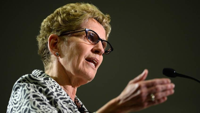 Wynne takes unusual approach of campaigning against the PM in Ontario election