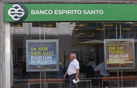 A man walks past an office of Portuguese bank Banco Espirito Santo in downtown Lisbon