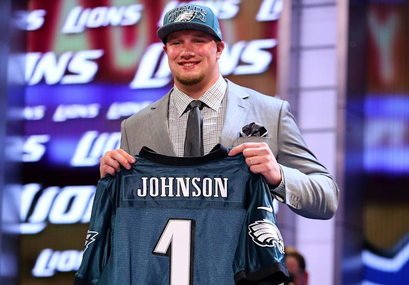 Lane Johnson of the Oklahoma Sooners holds up a jersey on stage after he was picked by the Philadelphia Eagles in the first round of the 2013 NFL Draft at Radio City Music Hall on April 25, 2013 in New York City