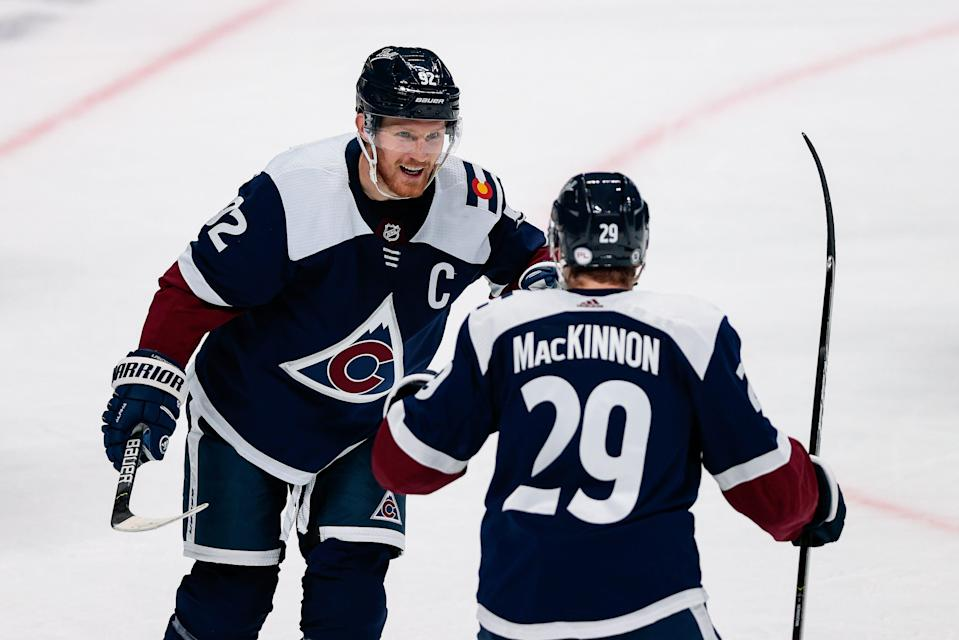 Colorado Avalanche left wing Gabriel Landeskog (92) celebrates his goal with center Nathan MacKinnon (29) earlier this season against the Minnesota Wild.