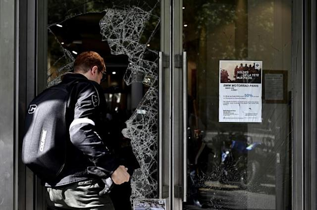 Tourists and locals were confronted by shards of broken glass in and around the Champs-Elysees in central Paris (AFP Photo/Philippe LOPEZ)