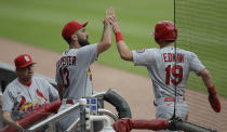 St. Louis Cardinals' Tommy Edman (19) is congratulated by Matt Carpenter (13) after scoring against the Atlanta Braves during the first inning of a baseball game Friday, June 18, 2021, in Atlanta. (AP Photo/Ben Margot)
