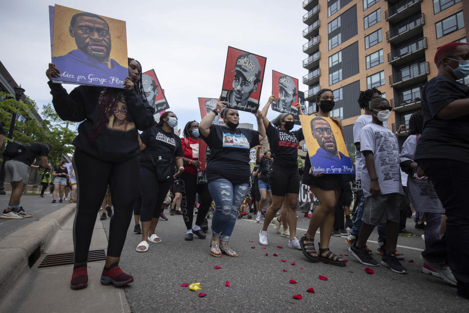 The family of Daunte Wright march for the one year anniversary of George Floyd's death on Sunday, May 23, 2021, in Minneapolis, Minn. (AP Photo/Christian Monterrosa)