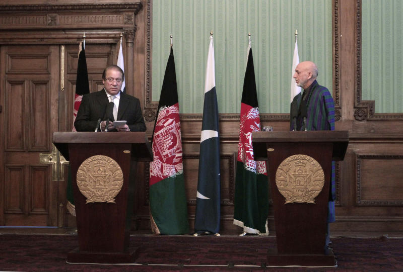 Afghan president Hamid Karzai, right, speaks during a joint press conference with Pakistani Prime Minister Nawaz Sharif in Kabul, Afghanistan, Saturday, Nov. 30, 2013. Sharif said Saturday that the recent release of a senior Taliban leader shows he is committed to helping bring peace to Afghanistan. (AP Photo/Rahmat Gul)