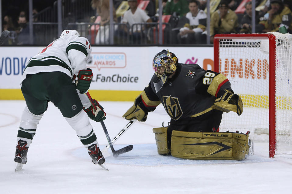 Vegas Golden Knights goalie Marc-Andre Fleury (29) makes a save against Minnesota Wild left wing Zach Parise (11) during the first period of Game 7 of an NHL hockey Stanley Cup first-round playoff series Friday, May 28, 2021, in Las Vegas. (AP Photo/Joe Buglewicz)