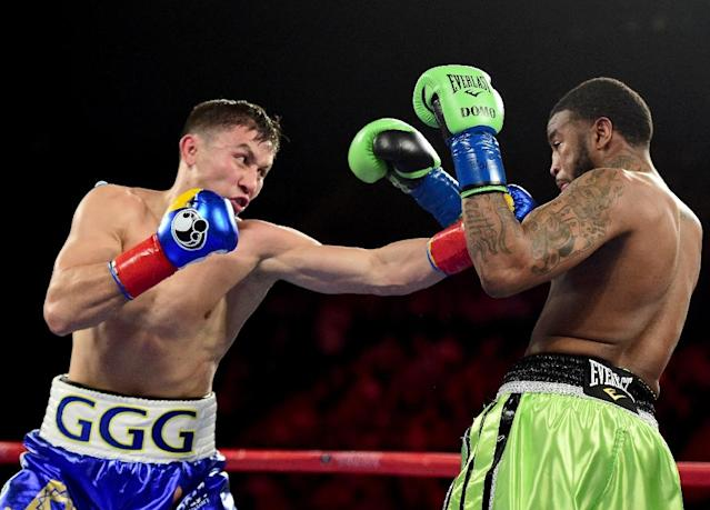 Gennady Golovkin (L) delighted a packed house of 16,353 fans at Los Angeles's famous Forum sports arena with an explosive performance to overwhelm Dominic Wade (AFP Photo/Harry How)