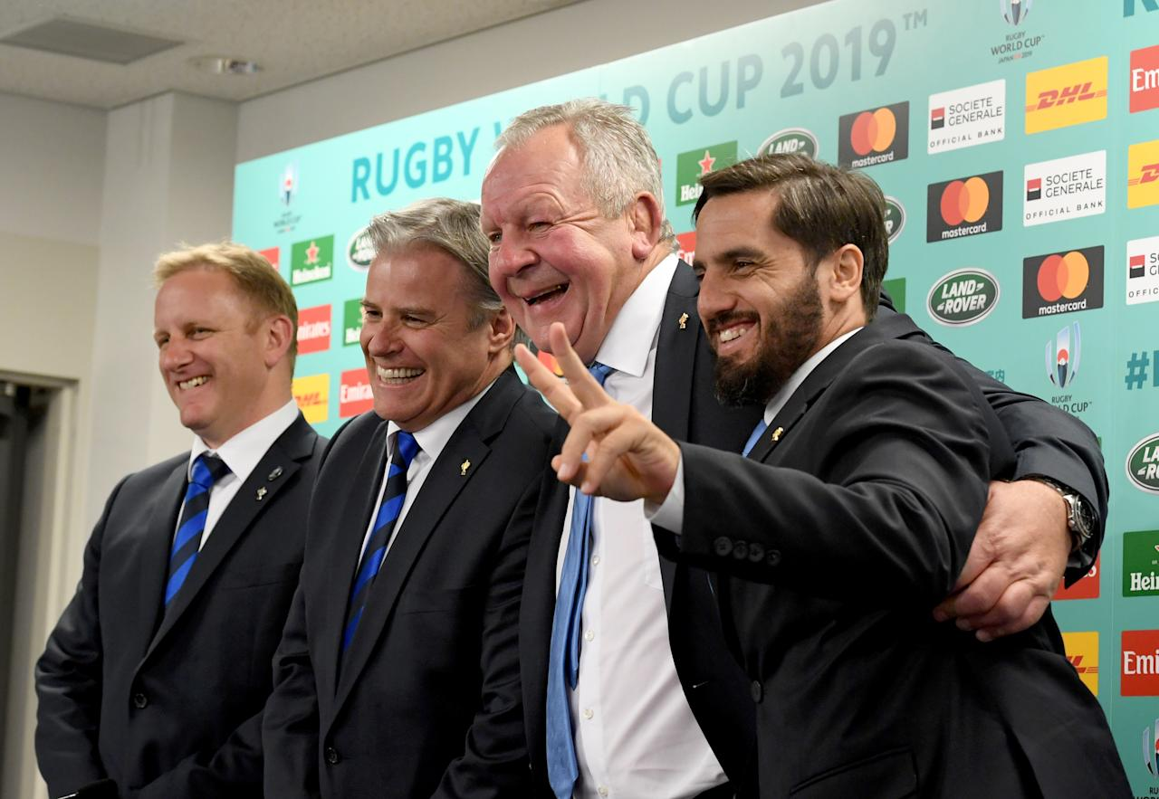 World Rugby chairman Bill Beaumont (2nd R) and deputy chairman Agustin Pichot (R) pose with World Rugby Chief Executive Brett Gosper (2nd L) and an unidentified officer (L) during their press conference following the Rugby World Cup Japan 2019 pool draw at Kyoto state guesthouse in Kyoto on May 10, 2017. (AFP Photo/Toshifumi KITAMURA)