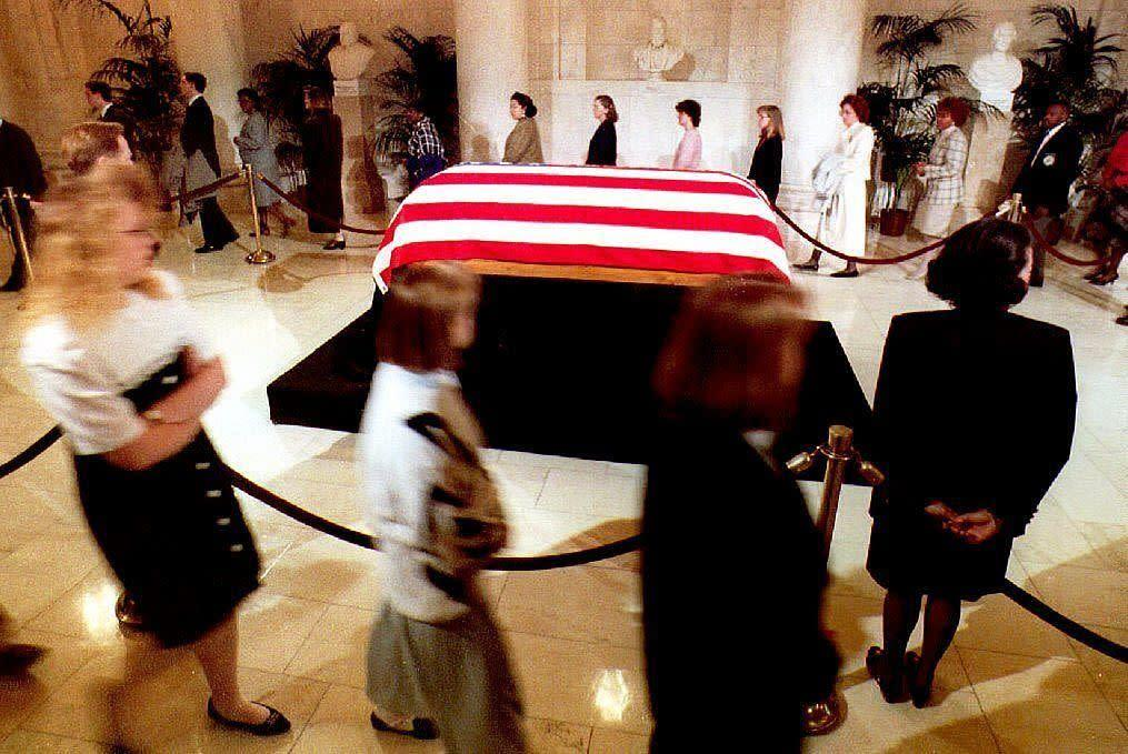 Former Justice Thurgood Marshall lies in repose in the Great Hall of the Supreme Court in Washington, D.C., on Jan. 27, 1993, as mourners file past.