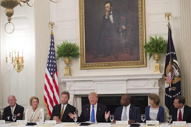 President Trump with Republican senators at the White House discussing the health care bill, July 19, 2017. (Photo: Saul Loeb/AFP)